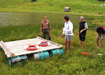 Raft building on a mountain lake
