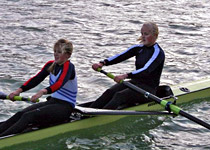 Team fun rowing in a scull