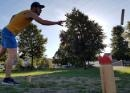 Kubb game with barbecue